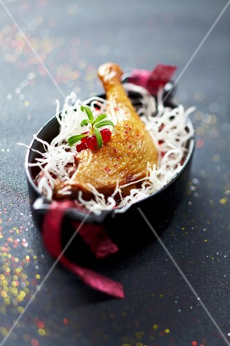 Roasted duckling leg with fried vermicellis