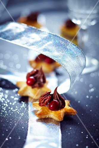 Star-shaped flaky pastry base topped with chocolate,pecan and cherry