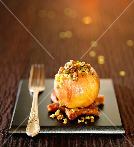 Baked apple stuffed with dried fruit and gingerbread