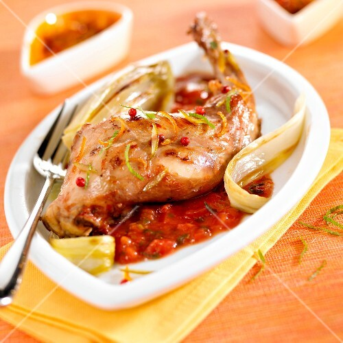 Rabbit with citrus fruit zests and tomato sauce