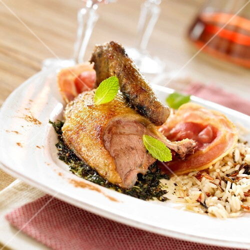 Roast pigeon with mint,pancetta and two rices