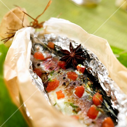 Spicy trout cooked in aluminium foil and wax paper