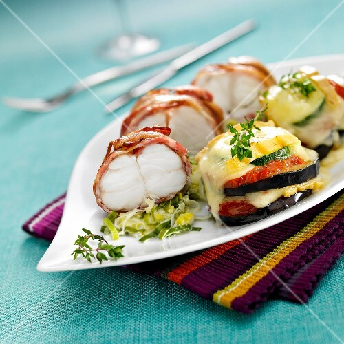 Monkfish wrapped in bacon with slowly cooked leeks,vegetable and Saint-Nectaire tian