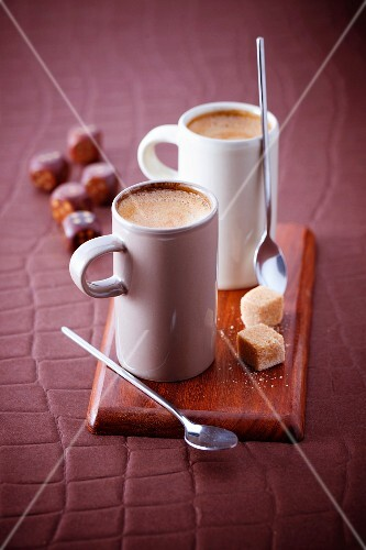 Cups of expresso coffee and dices