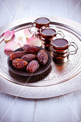 Dates and cups of tea on a tray