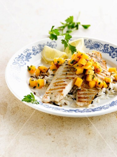 Grilled tilapia with diced mango and black and white rice