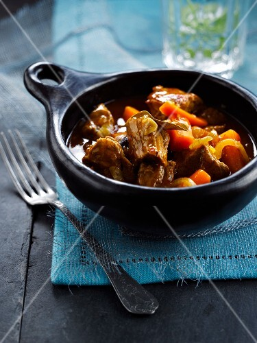 Beef stew with hot peppers,carrots and rum