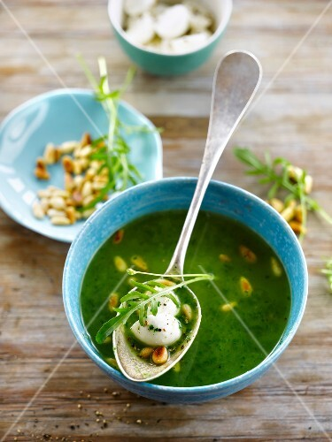 Rocket lettuce soup with mozzarella and pine nuts