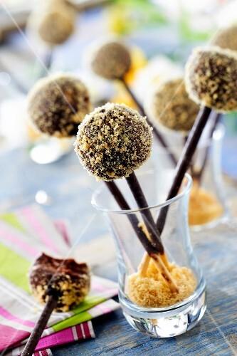 Dark chocolate ganache and crushed shortbread cookie lollipops on Mikado sticks