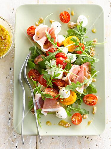 Rocket lettuce,cherry tomato,mozzarella and prosciutto salad