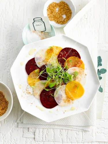 Three colored beetroot carpaccio with gomasio