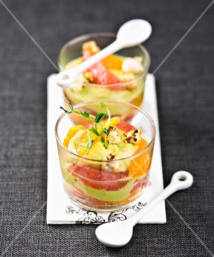 Citrus fruit carpaccio with guacamole and salty popcorn