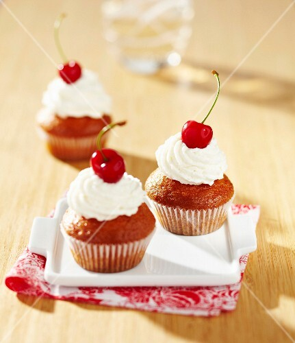 Muffin with whipped cream and cherries
