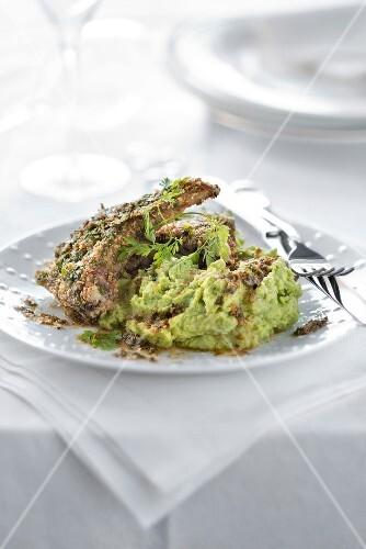 Lamb chops coated in herbs and crushed hazelnut,pea mash