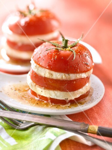 Layered tomatoes and mozzarella with vinaigrette