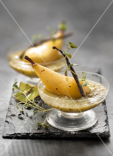Kiwi soup with stewed pears with vanilla-flavored syrup and lemon thyme