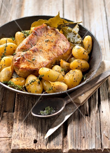 Slowly cooked shoulder of veal with Grenaille potatoes,thyme and bay leaves