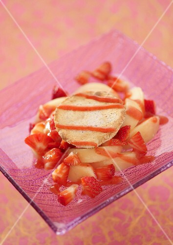 White peach and strawberry fruit salad with a coconut tuile