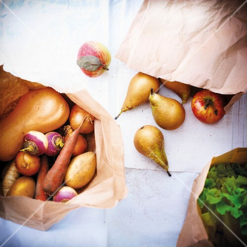 Autumn fruit and vegetables in a brown paper bag