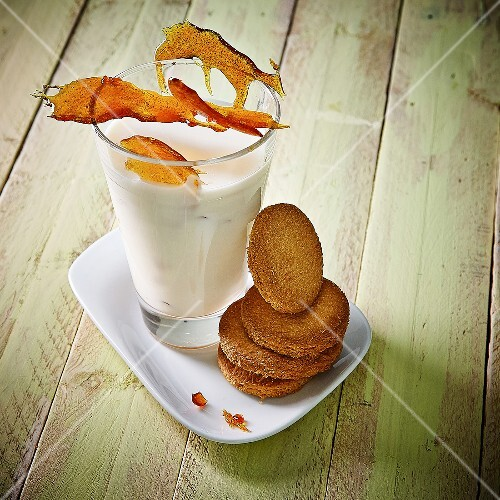 Glass of caramel milk and shortbread cookies