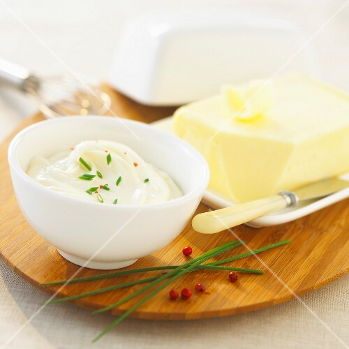 Bowl of thick cream and a slab of butter
