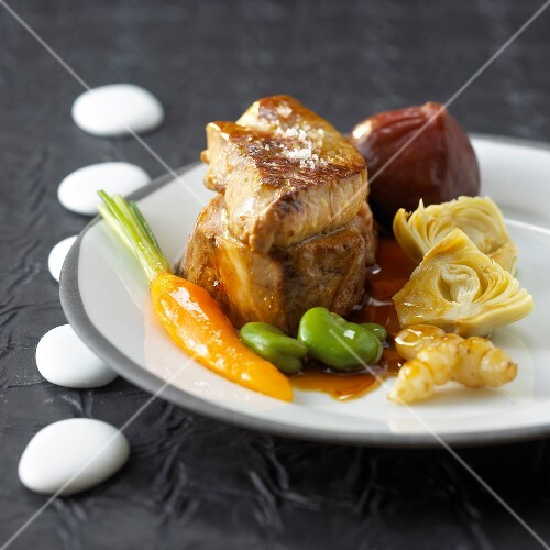 Veal Medaillon with foie gras,mixed vegetables and figs