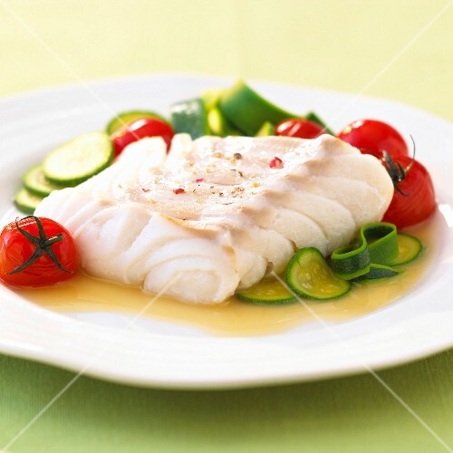 Fillet of cod with zucchinis and tomatoes