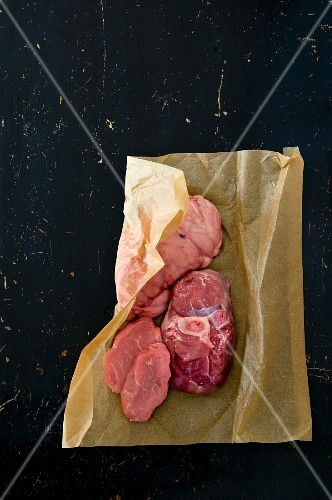 Raw meat in brown paper