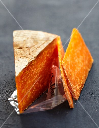 Portion and slices of Cheddar