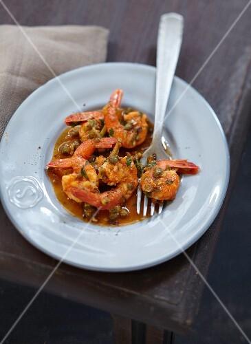Scampis in tomato and caper sauce