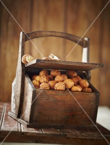 Wooden box of walnuts