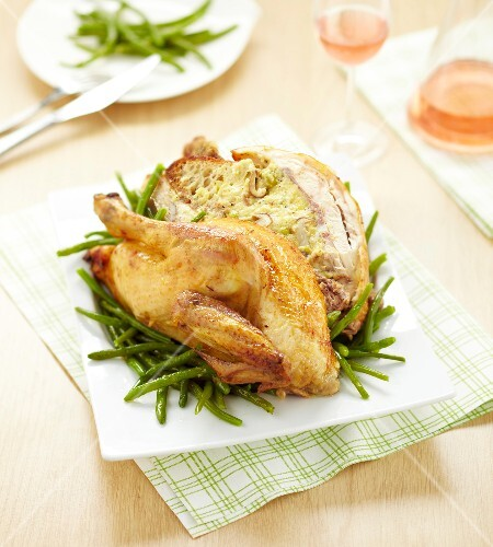 Roasted chicken stuffed with bread and mushrooms
