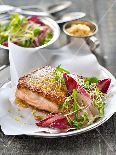 Salmon steak in quinoa crust,red chicory and rocket lettuce salad