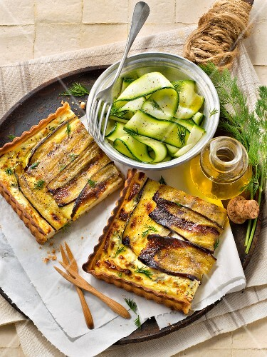 Brocciu and thinly sliced eggplant quiche with thinly stripped cucumber salad