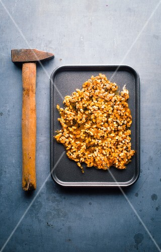 Caramelized mixed granola before crushing with a hammer