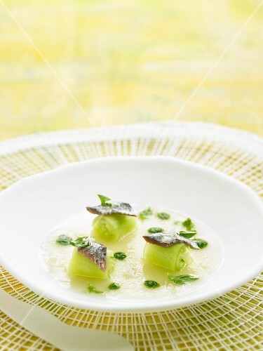 Melon soup with cucumber and anchovy rolls