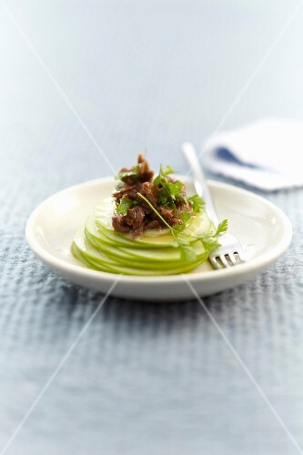 Stewed lamb with thinly sliced green apple