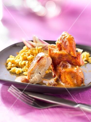 Tikka masala-style chicken with Indian-style orange lentils
