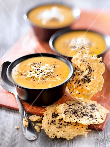 Cream of pumpkin soup with Emmental tuile and mustard seed tuiles