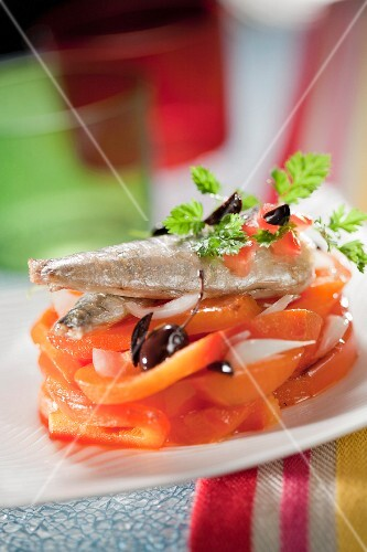 Stewed peppers with black olives,onions and preserved sardines