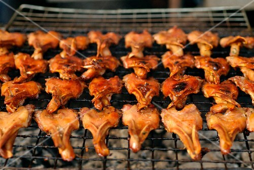 Grilled duck bills on a barbecue