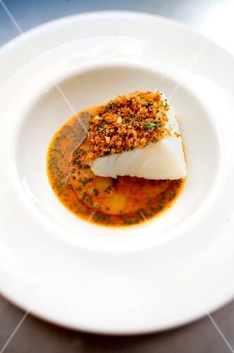 Piece of cod in tomato and potato crust