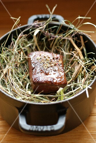 Fillet of venison cooked in hay
