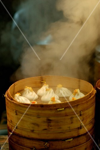 Steaming dumplings in a street in China