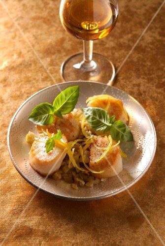 Scallops marinated in Cognac with basil and lemon zests