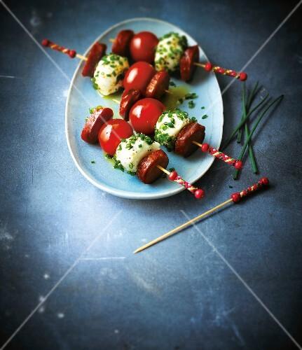 Cherry tomato,mozzarella and chorizo skewers with chives