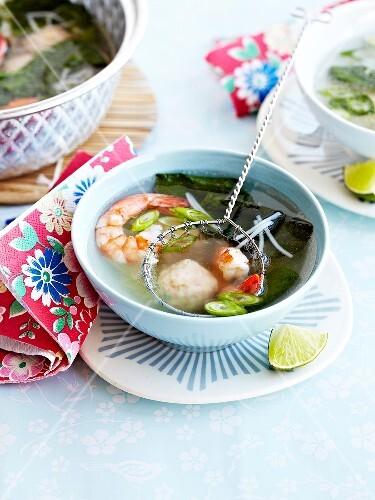 Scampi,fish dumpling and seaweed Asian broth