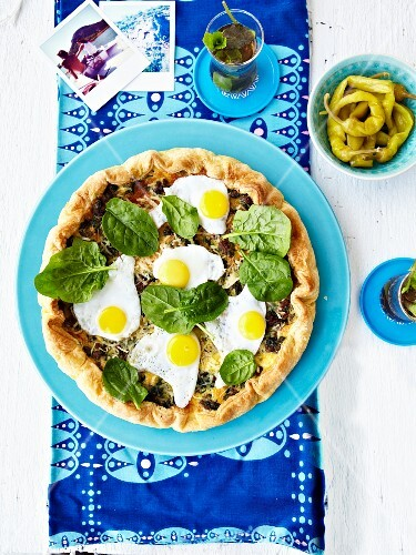 Spinach,ground beef and fried quail's egg quiche