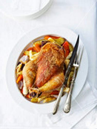 Roast chicken in coarse salt crust and autumn vegetables with thyme