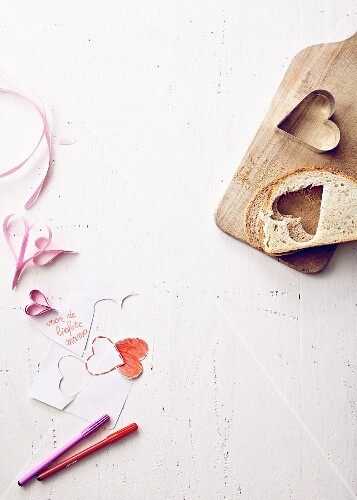 Cutting hearts out of a slice of bread